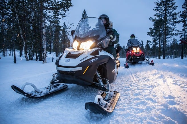 Snowmobiles at night